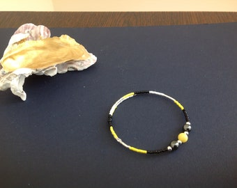 Yellow Jade and Hematite gemstone bracelet with Silver accent beads.