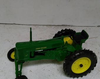 John Deere. 50 toy tractor