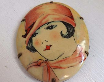 Vintage Art Deco celluloid flapper portrait brooch or pin lady or girl in pink blush cloche hat