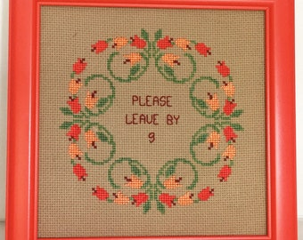 Please leave by 9. Finished and framed cross stitch.