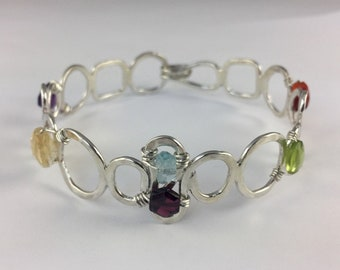 Sterling silver hand forged cuff bracelet with gemstones