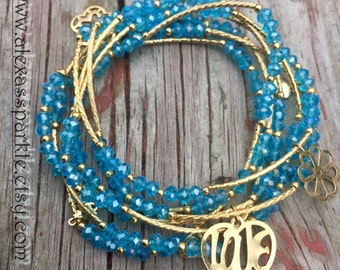 Sky blue bracelets with gold plated charms - Semanario color azul cielo con dijes de chapa de oro