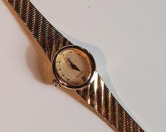 Vintage gold coloured slim ladies Accurist watch