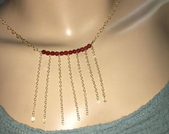 Carnelian necklace on gold chains and chains chains cascading