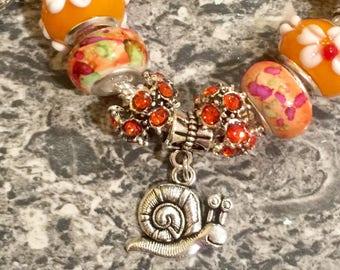 Orange snail euro bracelet