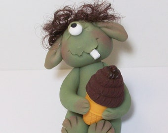 One eyed ice cream monster with brown hair and one tooth. polymer clay monster