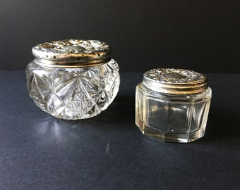 Two silver topped dressing table pots.