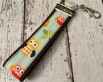 Owl print key fob wristlet on brown cotton webbing with swivel lobster clasp
