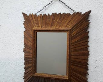 Carved wooden mirror.