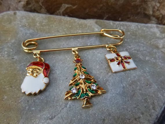 1995 Avon Holiday Charm Vintage Pin | Santa, Christmas Tree, Present Dangling from Gold Tone Safety Pin | Christmas Brooch Book Piece