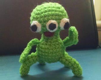 Green alien baby rattle