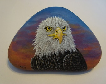 Bald Eagle Portrait hand painted on a rock by Ann Kelly