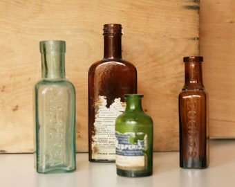 Vintage Pharmacy Bottles-collection of 4 glass bottles of pharmaceutical products Carlo Erba-Sandoz