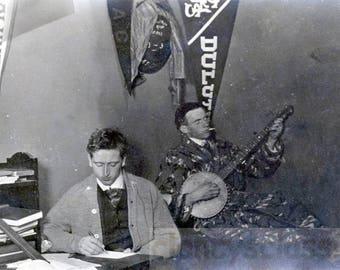 Vintage photo 1913 College Boys Dorm Room Pennants Plays Banjo Music and SMokes