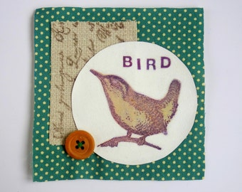 Bird small original textile art patch. Nature mixed media in browns/neutrals on spotty green & white fabric