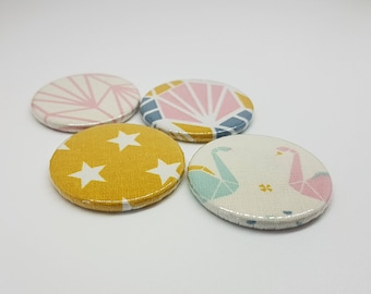 Set of 4 fabric covered round magnets. Magnet with 4 matching fabric, pink, mustard yellow, blue. Swans and Scandinavian colors.