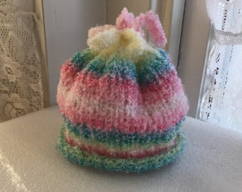 Darling pink, blue, green, yellow and white striped hat for infants