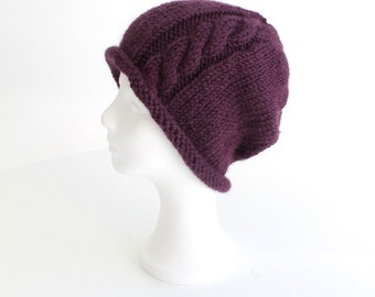 Hand knit beanie hat with cable and rolled brim purple