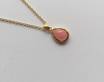 Strawberry Pink Teardrop Gold Framed Pendant on a gold necklace
