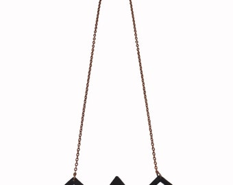 Donner Necklace - hand sawed geometric pendant necklace