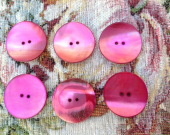 Set of six red tinted Pearl buttons