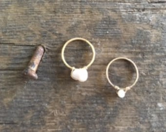 Gold Shell and Pearl Stacking Ring Set.