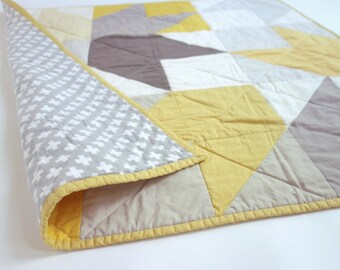 Arrow design quilt for baby. Grey, gold and white. Gender neutral.