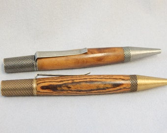 Graduation gift, a gift for her, wood twist style ballpoint pens, one of bacote and antique brass, one of maple burl and antique silver