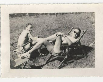 Vintage BW photo - Two young men soaking up the sun