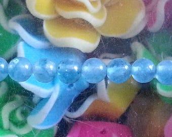 1 Pearl blue sponge quartz with 4mm hole 1 mm
