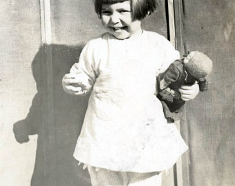 Vintage photo little girl cutie pie holds toy doll RPPC