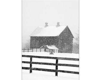 Rural Wood Barn and Farm Pasture Fence during Winter Snowstorm in Cascade Michigan A Black and White Fine Art Landscape Photograph