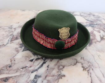 Vintage green bowler hat with pin and ribbon