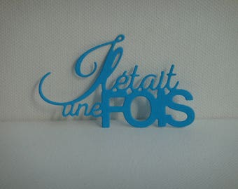 """Cut phrase """"Once upon a time"""" paper for creating dark blue design"""