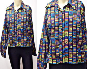 FLower power,funky ,bright flowers on black polyester,blouse