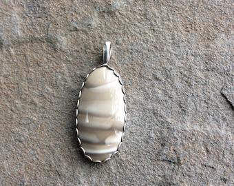 Polish flint silver pendant