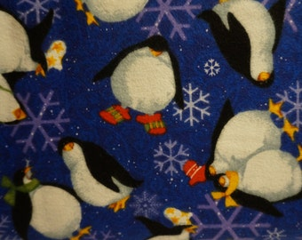 Roly Poly Penguins - Blue; sold by the yard