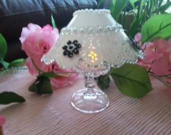 Lamp, chandelier wine glass shade with plastic scrapbook paper, glassware, table center