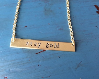"""The Outsiders inspired """"Stay Gold"""" hand stamped simple bar necklace"""