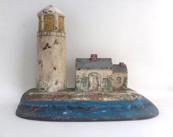 Charming Cast Iron Painted Lighthouse Doorstop
