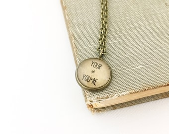 Your You're. They aren't equal.  Tiny Charm Necklace.  Grammar Necklace. 18in.