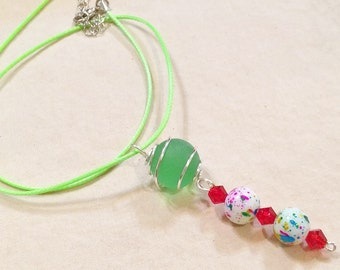 Silver Wire Caged Marble Pendant Necklace With Light Green Cord