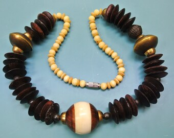Large vintage 1960 BOHO TRIBAL ETNIC handcrafted natural organic bone/ wood/ brass necklace with x-large brass centerpiece bead