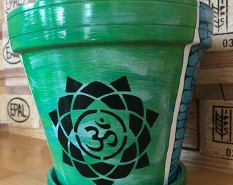 Flower pot in turquoise with OmZeichen
