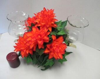 Candle holder with Orange floral arrangement  votive cups.