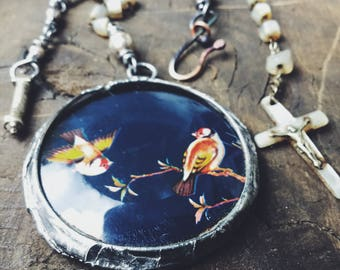 Assemblage necklace | rosary necklace, rosary assemblage, bird necklace, soldered glass charm,  found object jewelry, religious jewelry