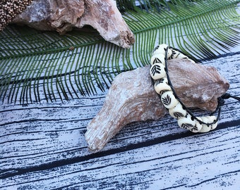 Handcrafted jewelrySingle wrap carved bone and leather bracelet