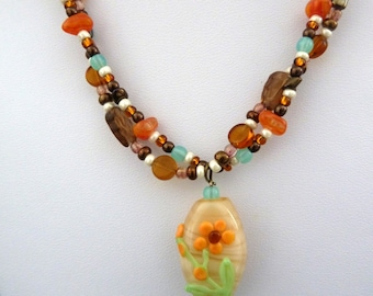 handmade lampwork necklace, orange flower beads jewellery UK