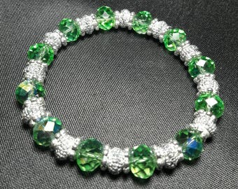 Sparkling green crystal bracelet with glittering silver accents