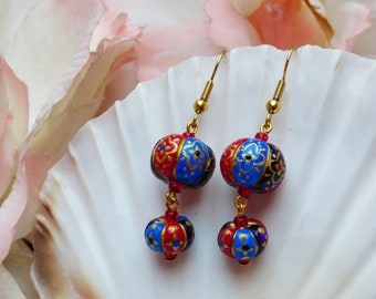 Folk art earrings in Blue Red and Purple with Gold Patterned detail